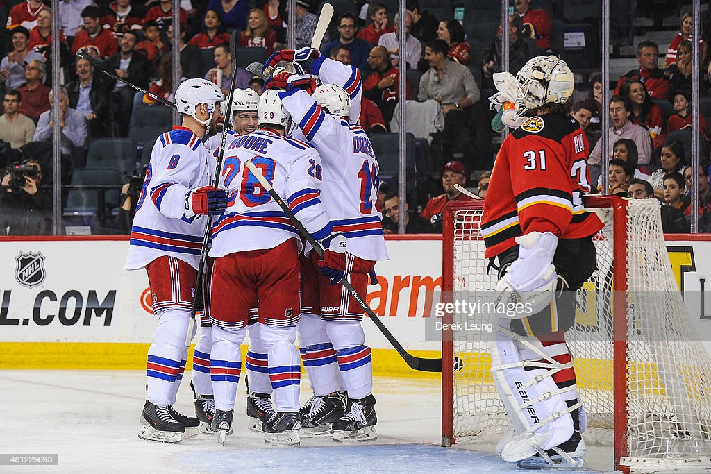 Kevin Klein #8, Raphael Diaz #4, Dominic Moore #28, and Derek Dorsett #15 of the New York Rangers celebrate Raphael Diaz's goal against Karri Ramo #31 of the Calgary Flames during an NHL game at Scotiabank Saddledome on March 28, 2014 in Calgary, Alberta, Canada.