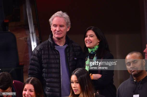 Kevin Kline and Phoebe Cates attend the Phoenix Suns vs New York Knicks game at Madison Square Garden on January 13 2014 in New York City