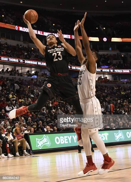 Kevin Knox II of the boys east team is defended by Billy Preston of the boys west team during the 2017 McDonalds's All American Game on March 29 2017...