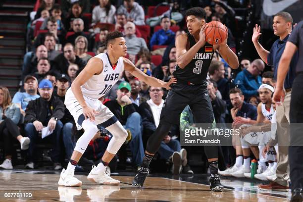 Kevin Knox II of the USA Junior Select Team defends against Kostja Mushidi of the World Select Team during the game on April 7 2017 at the MODA...