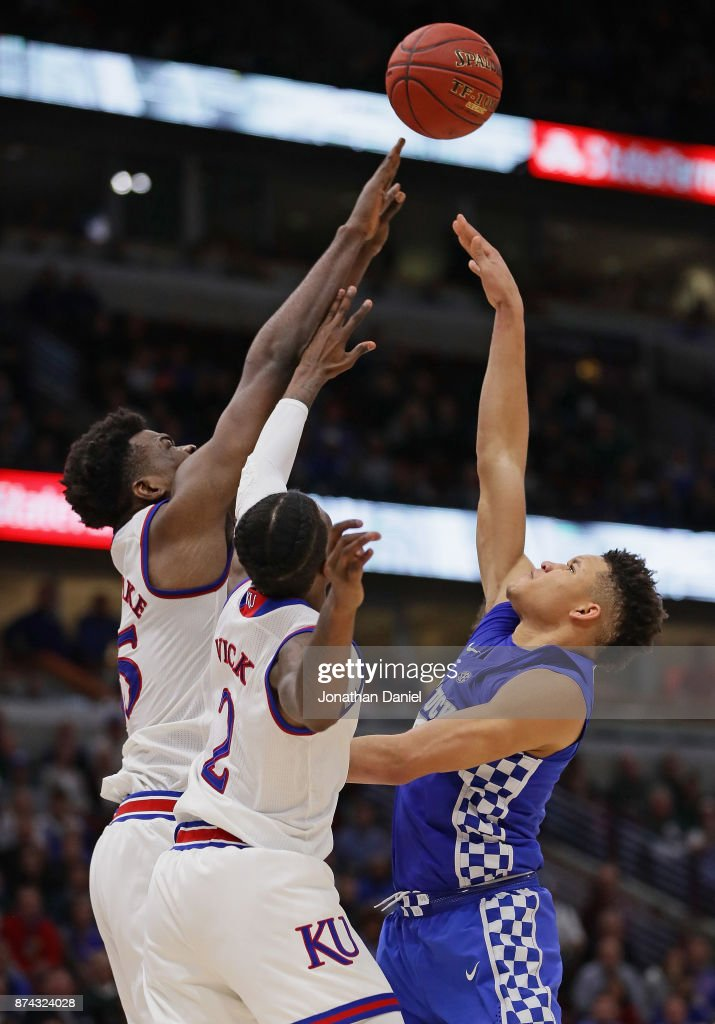 Kevin Knox #5 of the Kentucky Wildcats shoots over Udoka Azubuike #35 and Lagerald Vick #2 of the Kansas Jayhawks on his way to a game-high 20 points during the State Farm Champions Classic at the United Center on November 14, 2017 in Chicago, Illinois. Kansas defeated Kentucky 65-61.