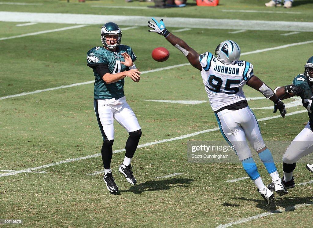 Kevin Kolb #4 of the Philadelphia Eagles passes against Charles Johnson #95 of the Carolina Panthers at Bank Of America Stadium on September 13, 2009 in Charlotte, North Carolina.
