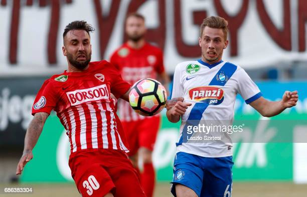 Kevin Korozman of MTK Budapest competes for the ball with Jose Antonio Delgado Villar 'Nono' #30 of DVTK during the Hungarian OTP Bank Liga match...