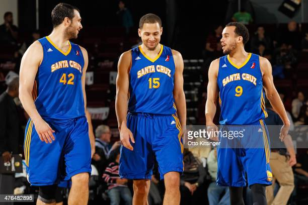 Kevin Kotzur Mychel Thompson and Cameron Jones of the Santa Cruz Warriors return to the court after a time out during an NBA DLeague game against the...