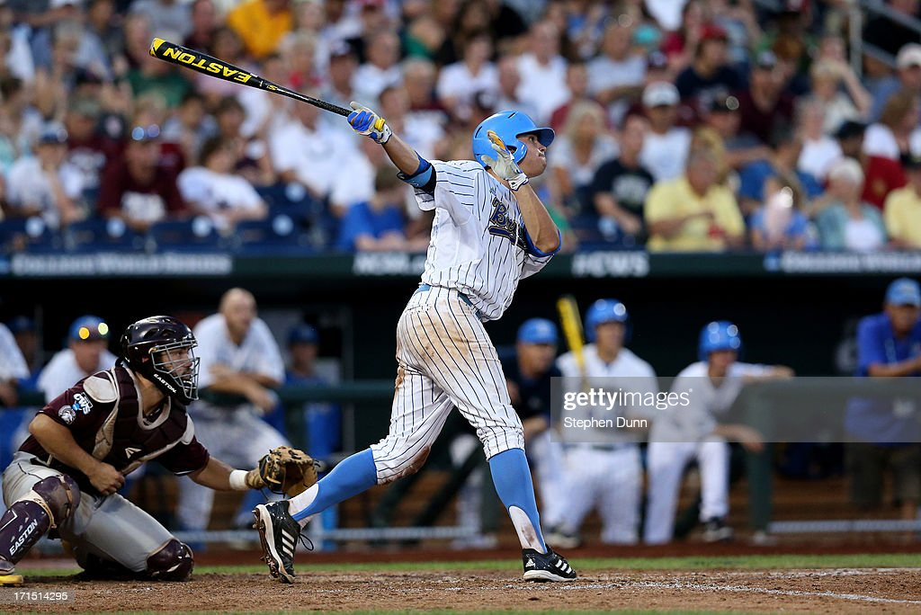 Kevin Kramer #7 of the UCLA Bruins hits a sacrifice fly to bring the Bruins' fifth run against the Mississippi State Bulldogs in the fifth inning during game two of the College World Series Finals on June 25, 2013 at TD Ameritrade Park in Omaha, Nebraska.