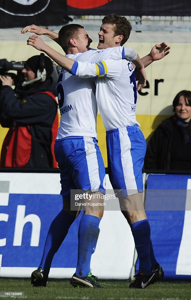 Kevin Kraus of Heidenheim (L) celebrates his team's second goal with team mate <a gi-track='captionPersonalityLinkClicked' href=/galleries/search?phrase=Tim+Goehlert&family=editorial&specificpeople=5890181 ng-click='$event.stopPropagation()'>Tim Goehlert</a> during the third Bundesliga match between 1. FC Heidenheim and Wacker Burghausen at Voith-Arena on March 16, 2013 in Heidenheim, Germany.