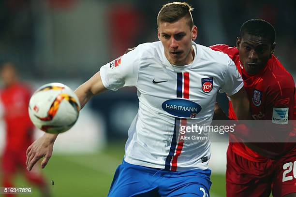 Kevin Kraus of Heidenheim is challenged by Taiwo Awoniyi of Frankfurt during the Second Bundesliga match between 1 FC Heidenheim and FSV Frankfurt at...