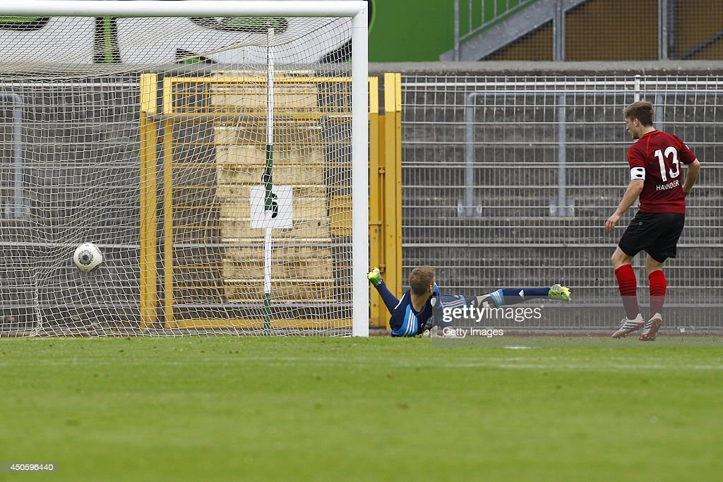 Kevin Krottke of Hannover scores against Niklas Klinger of Wolfsburg to 2:2 during the A Juniors Bundesliga Semi Final between U19 VfL Wolfsburg and U19 Hannover 96 at Stadion am Elsterweg on June 14, 2014 in Wolfsburg, Germany.