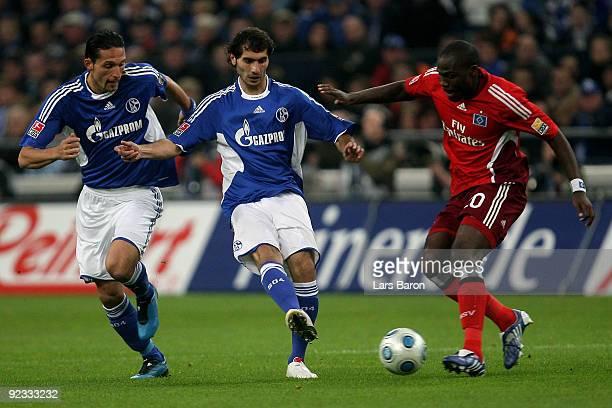 Kevin Kuranyi and Halil Altintop of Schalke challenged Guy Demel of Hamburg during the Bundesliga match between FC Schalke 04 and Hamburger SV at...
