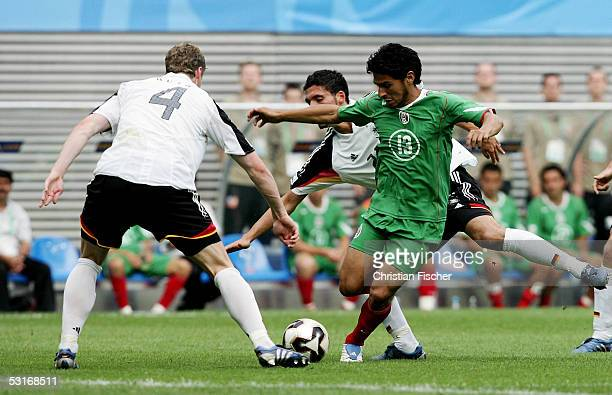 Kevin Kuranyi and Robert Huth of Germany fights for the ball against Rafael Marquez Lugo of Mexico during the match between Germany and Mexico for...