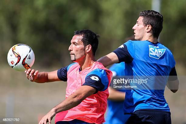 Kevin Kuranyi is challenged by Fabian Schaer a TSG 1899 Hoffenheim Training session on July 31 2015 in Hoffenheim Germany