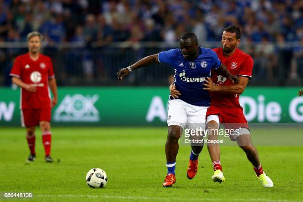 Kevin Kuranyi of Euro All Stars challenges Gerald Asamoah of Eurofighter and Friends during the 20 years of Eurofighter match between Eurofighter and...
