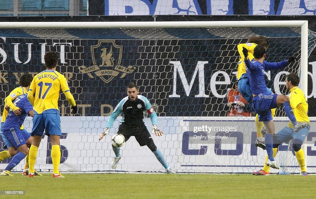 Kevin Kuranyi (2nd R) of FC Dynamo Moscow scores the opening goal past goalkeeper Stipe Pletikosa of FC Rostov Rostov-on-Don during the Russian Premier League match between FC Dynamo Moscow and FC Rostov Rostov-on-Don at the Arena Khimki Stadium on March 30, 2013 in Khimki, Russia.