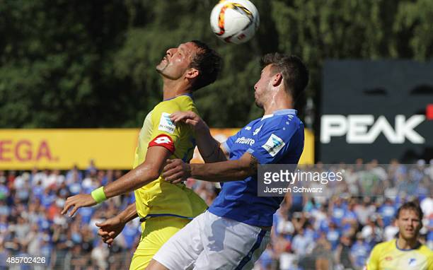 Kevin Kuranyi of Hoffenheim and Jerome Gondorf of Darmstadt jump for a header during the Bundesliga match between SV Darmstadt 98 and 1899 Hoffenheim...