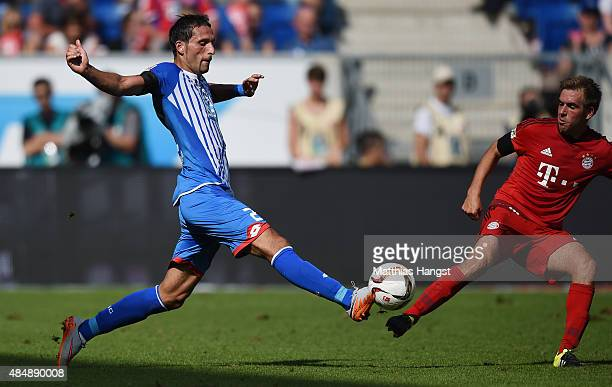 Kevin Kuranyi of Hoffenheim and Philipp Lahm of Muenchen compete for the ball during the Bundesliga match between 1899 Hoffenheim and FC Bayern...