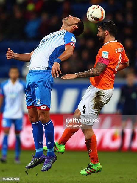Kevin Kuranyi of Hoffenheim jumps for a header with Aytac Sulu of Darmstadt during the Bundesliga match between 1899 Hoffenheim and SV Darmstadt 98...