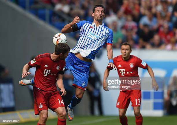 Kevin Kuranyi of Hoffenheim jumps for a header with Xabi Alonso of Muenchen during the Bundesliga match between 1899 Hoffenheim and FC Bayern...