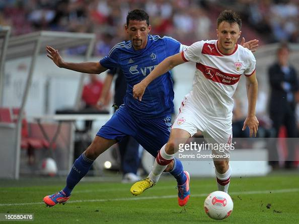 Kevin Kuranyi of Moscow and William Kvist of Stuttgart battle for the ball during the UEFA Europa League Qualifying PlayOff match between VfB...