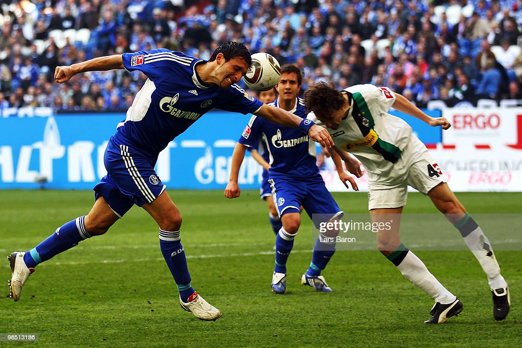Kevin Kuranyi of Schalke goes up for a header with Roel Brouwers of Moenchengladbach during the Bundesliga match between FC Schalke 04 and Borussia...