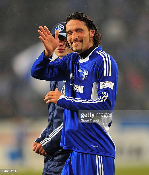 Kevin Kuranyi of Schalke looks happy as he waves to a fan at the end of the Bundesliga match between FC Schalke 04 and Werder Bremen at the...