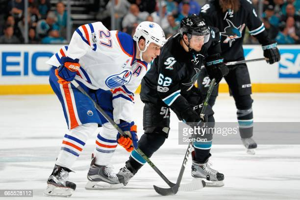 Kevin Labanc of the San Jose Sharks and Milan Lucic of the Edmonton Oilers look on during a NHL game at SAP Center at San Jose on April 6 2017 in San...