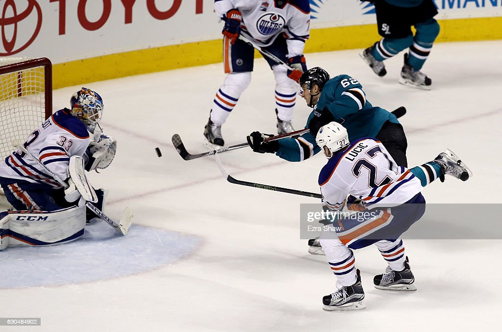 Kevin Labanc #62 of the San Jose Sharks scores the game-winning goal on Cam Talbot #33 of the Edmonton Oilers in overtime at SAP Center on December 23, 2016 in San Jose, California.