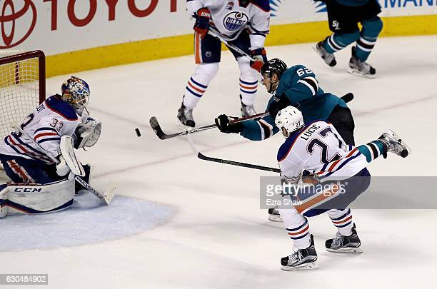 Kevin Labanc of the San Jose Sharks scores the gamewinning goal on Cam Talbot of the Edmonton Oilers in overtime at SAP Center on December 23 2016 in...