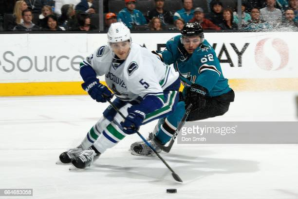 Kevin Labanc of the San Jose Sharks skates against Luca Sbisa of the Vancouver Canucks at SAP Center at San Jose on April 4 2017 in San Jose...