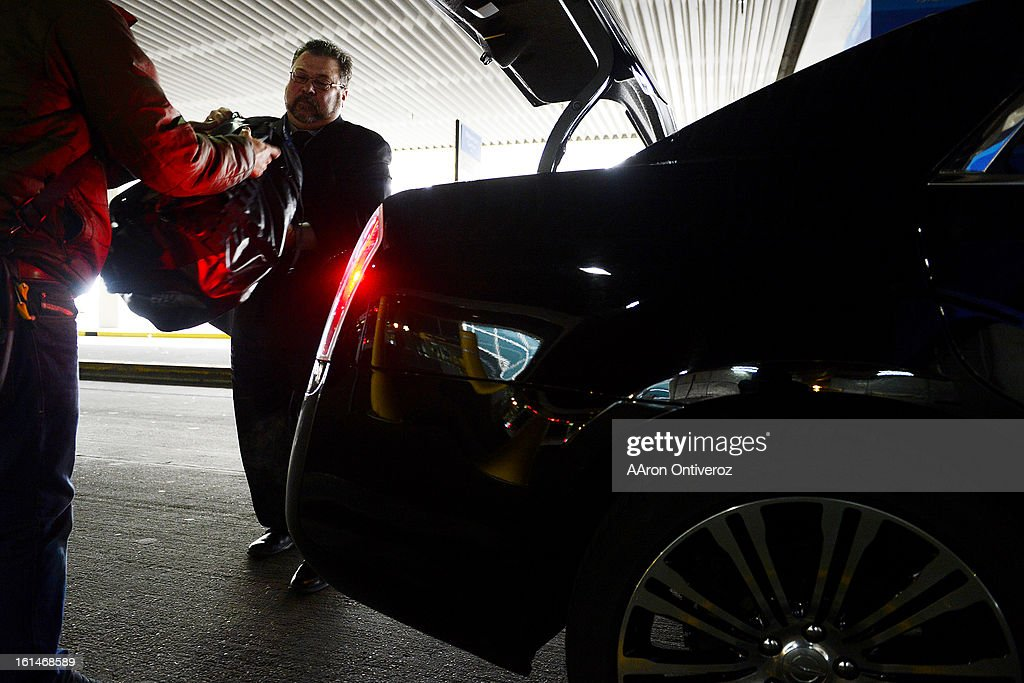 Kevin Labonte, owner of Special Times Limousine, helps a customer unload his luggage at DIA. Labonte supplements his own fares with those he contracts out from Uber. State legislators may enact proposed changes supported by the taxi community that say Uber is an unregulated service. Though not regulated, Uber merely connects private drivers, who comply with all PUC regulations, to customers.