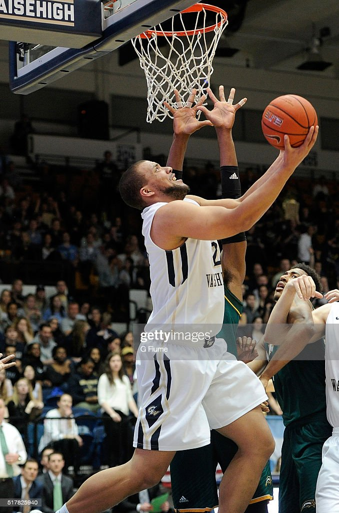 Kevin Larsen of the George Washington Colonials drives to the hoop against the George Mason Patriots at the Charles E Smith Athletic Center on March...