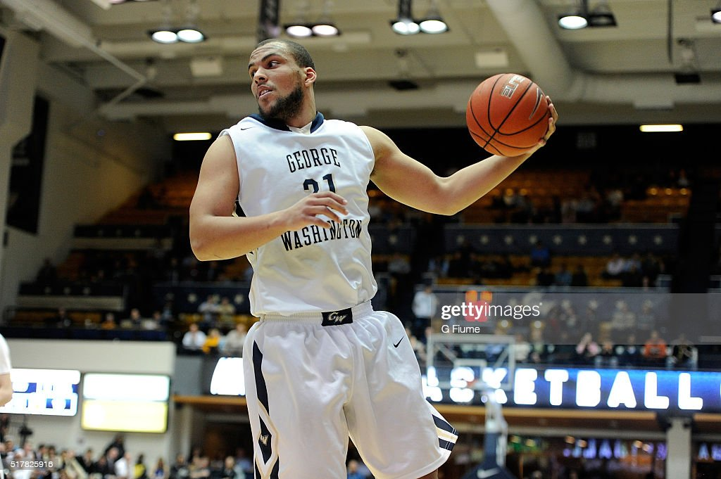 Kevin Larsen of the George Washington Colonials grabs a rebound against the George Mason Patriots at the Charles E Smith Athletic Center on March 1...