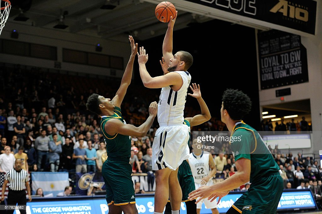 Kevin Larsen of the George Washington Colonials shoots the ball against the George Mason Patriots at the Charles E Smith Athletic Center on March 1...