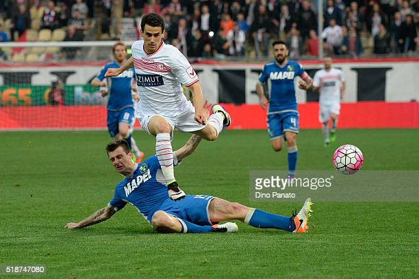 Kevin Lasagna of Carpi FC competes with Francesco Acerbi of US Sassuolo during the Serie A match between Carpi FC and US Sassuolo Calcio at Alberto...