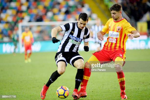 Kevin Lasagna of Udinese Calcio competes with Luca Antei of Benevento Calcio during the Serie A match between Udinese Calcio and Benevento Calcio at...
