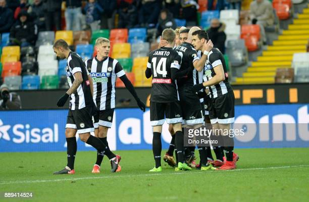 Kevin Lasagna of Udinese Calcio is mobbed by team mates after scoring his teams second goal goal during the Serie A match between Udinese Calcio and...