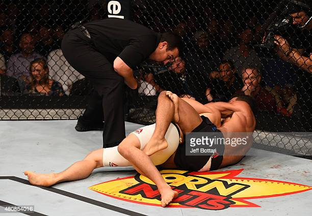 Kevin Lee attempts to submit James Moontasri in their lightweight bout during the UFC event at the Valley View Casino Center on July 15 2015 in San...