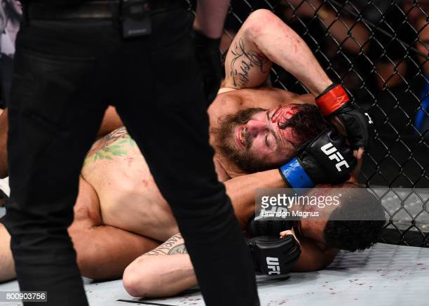 Kevin Lee attempts to submit Michael Chiesa with a rear choke in their lightweight bout during the UFC Fight Night event at the Chesapeake Energy...