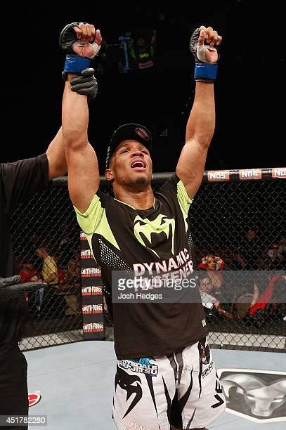 Kevin Lee celebrates after defeating Jesse Ronson in their flyweight fight during the Ultimate Fighter Finale inside the Mandalay Bay Events Center...