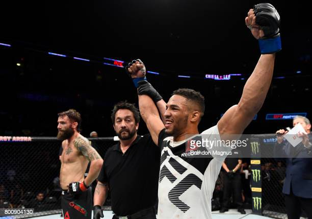 Kevin Lee celebrates after his submission victory over Michael Chiesa in their lightweight bout during the UFC Fight Night event at the Chesapeake...