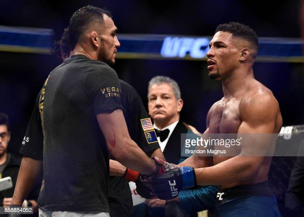 Kevin Lee congratulates Tony Ferguson after his submission victory in their interim UFC lightweight championship bout during the UFC 216 event inside...