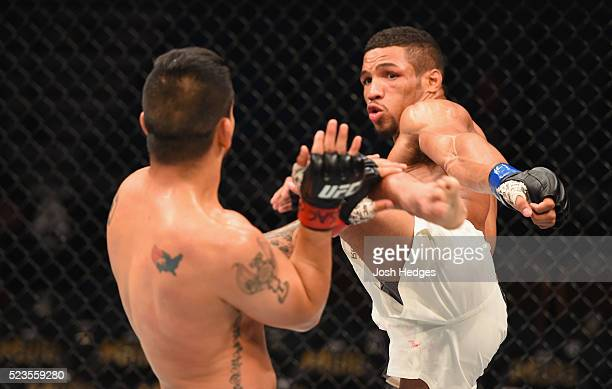 Kevin Lee kicks Efrain Escudero of Mexico in their lightweight bout during the UFC 197 event inside MGM Grand Garden Arena on April 23 2016 in Las...