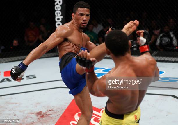 Kevin Lee kicks Francisco Trinaldo of Brazil in their lightweight bout during the UFC Fight Night event at CFO Centro de Formaco Olimpica on March...