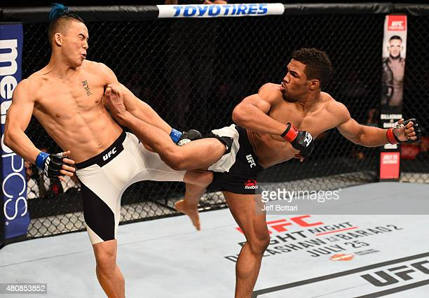 Kevin Lee kicks James Moontasri in their lightweight bout during the UFC event at the Valley View Casino Center on July 15 2015 in San Diego...