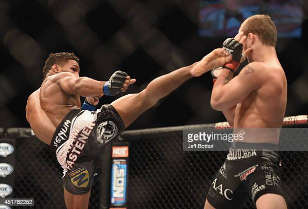 Kevin Lee kicks Jesse Ronson in their flyweight fight during the Ultimate Fighter Finale inside the Mandalay Bay Events Center on July 6 2014 in Las...