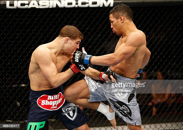 Kevin Lee knees Al Iaquinta in their lightweight fight at the UFC 169 event inside the Prudential Center on February 1 2014 in Newark New Jersey