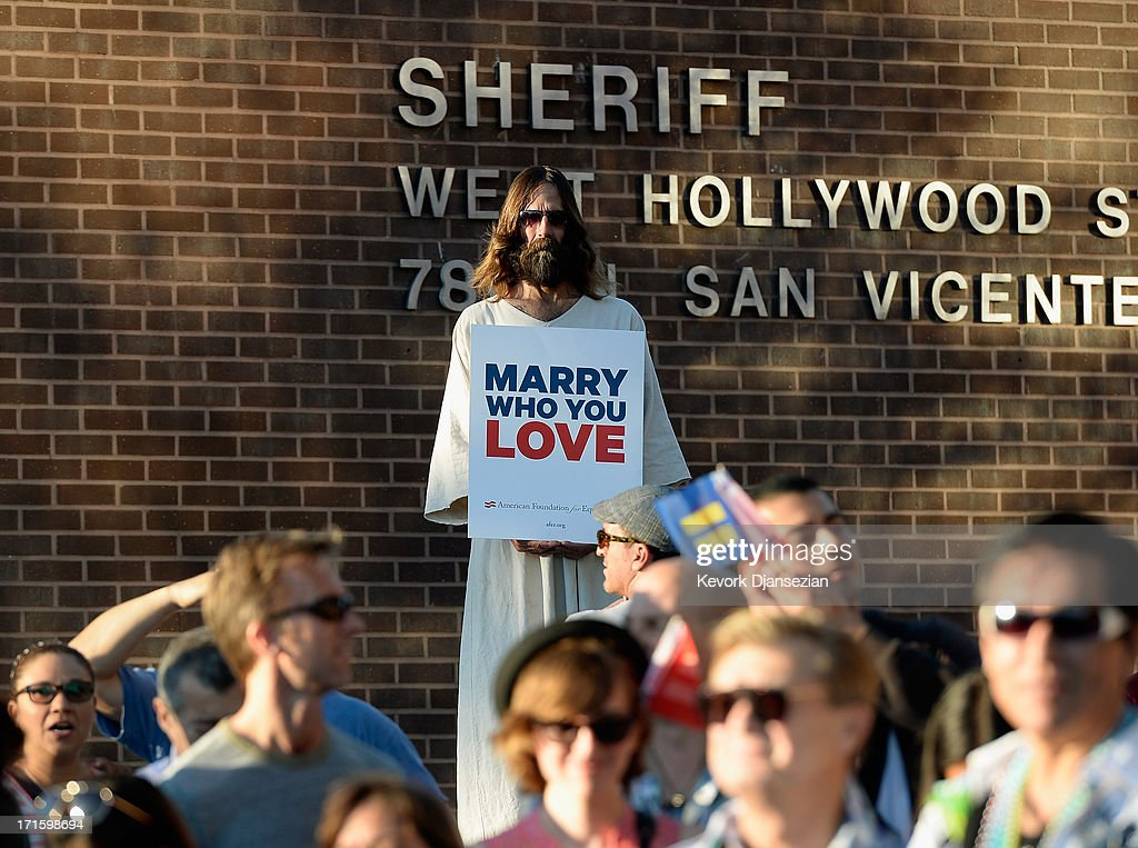 Kevin Lee Light, known as West Hollywood Jesus, holds a sign as he celebrates the US Supreme Court ruling during a community rally on June 26, 2013 in West Hollywood, California. The Supreme Court struck down the Defense of Marriage Act (DOMA) and ruled that supporters of California's ban on gay marriage, Proposition 8, could not defend it before the Supreme Court.