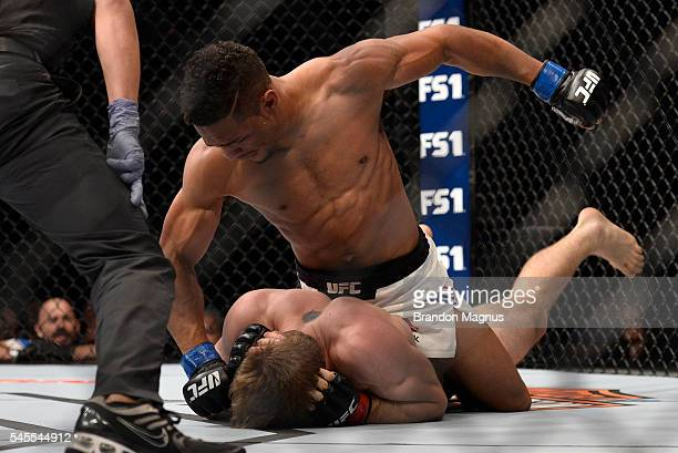Kevin Lee punches down at Jake Matthews of Australia in their lightweight bout during The Ultimate Fighter Finale event at MGM Grand Garden Arena on...
