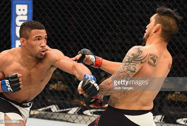 Kevin Lee punches Efrain Escudero of Mexico in their lightweight bout during the UFC 197 event inside MGM Grand Garden Arena on April 23 2016 in Las...