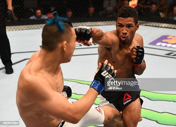 Kevin Lee punches James Moontasri in their lightweight bout during the UFC event at the Valley View Casino Center on July 15 2015 in San Diego...