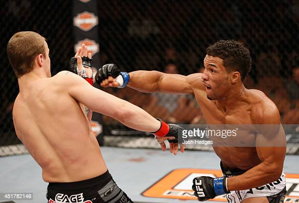 Kevin Lee punches Jesse Ronson in their flyweight fight during the Ultimate Fighter Finale inside the Mandalay Bay Events Center on July 6 2014 in...